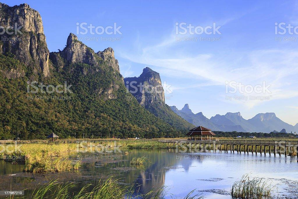 Mountains and bridge on lake at Sam Roi Yod National Park stock photo