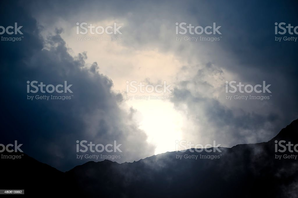 Mountains and Cloudy Sky stock photo