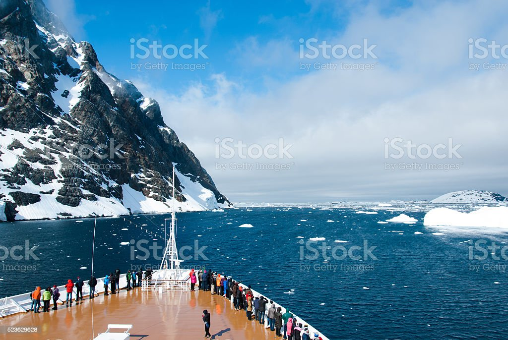 Mountains and cruise ship in Antarctica in sunny day stock photo