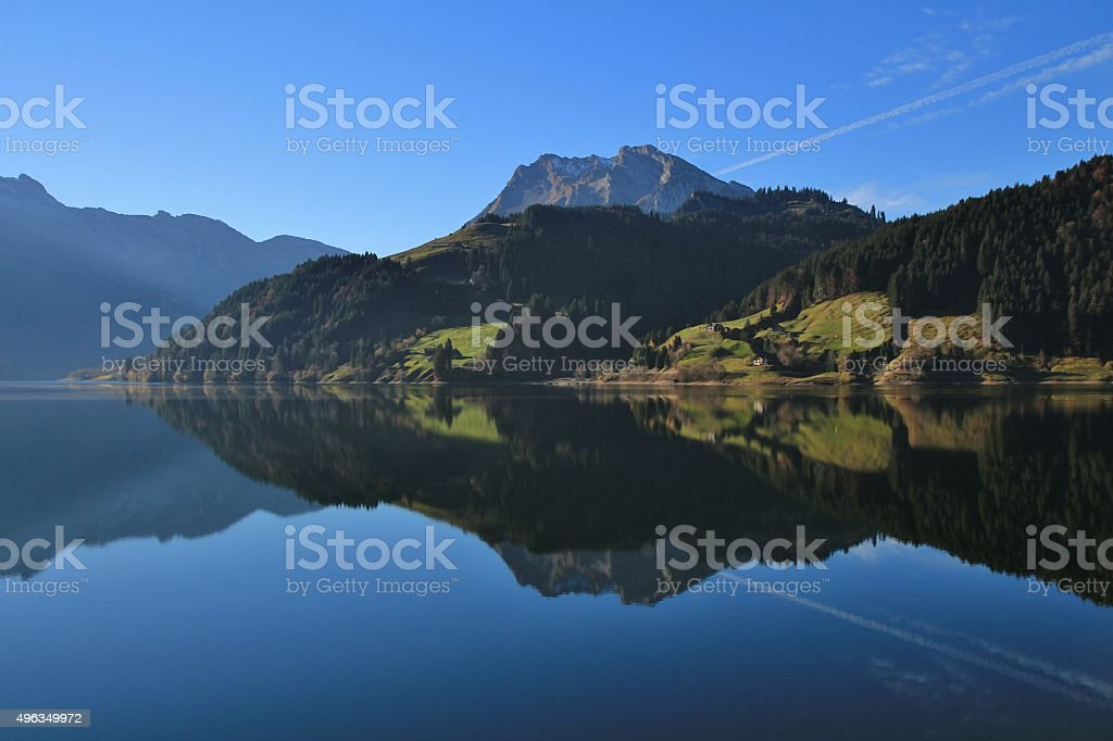 Mountains and forest reflecting in lake Wagital stock photo