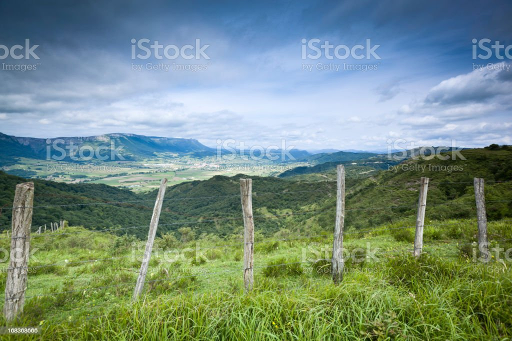 mountains and green field stock photo