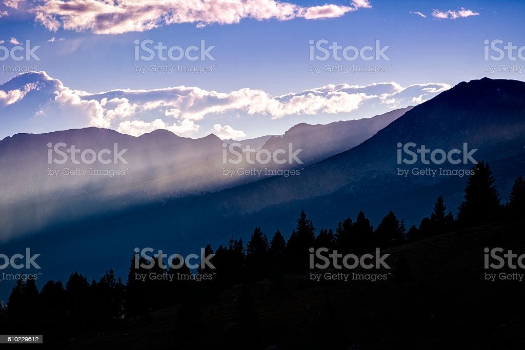 Mountains and Interesting Clouds with Beams of Light stock photo