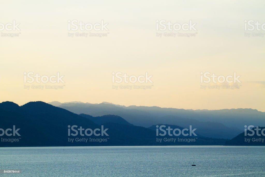 Mountains and lake Erawan in Kanchanburi stock photo