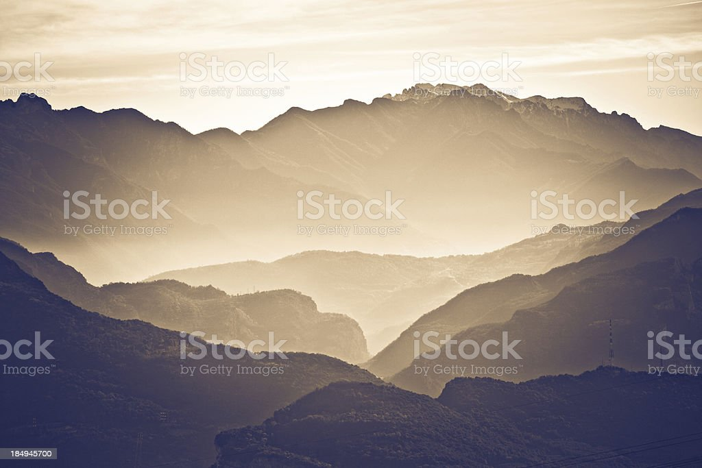 Mountains and Mist in Natural Park at Sunrise, Dolomites royalty-free stock photo