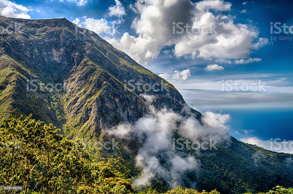 Mountains and ocean high view with clouds stock photo