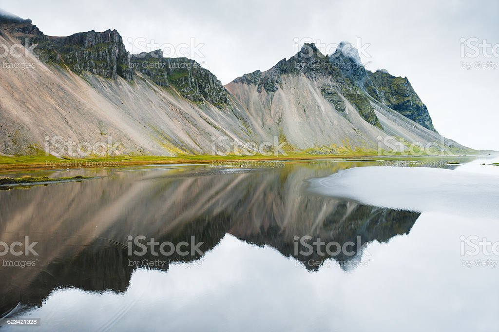 Mountains and reflections. East Iceland stock photo