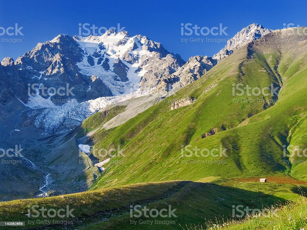 Mountains and shack royalty-free stock photo
