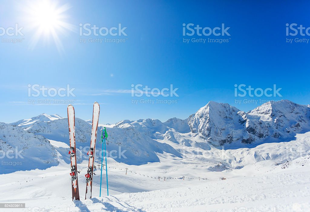 Mountains and ski equipments on slope stock photo