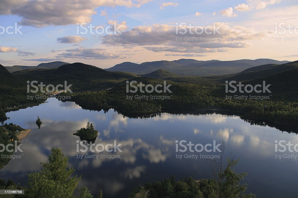 Mountains and Sky Reflection on Lake at Sunset in Summer stock photo