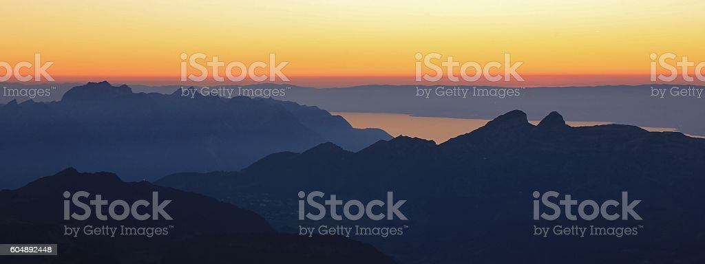 Mountains and stripe of Lake Geneva at sunset stock photo