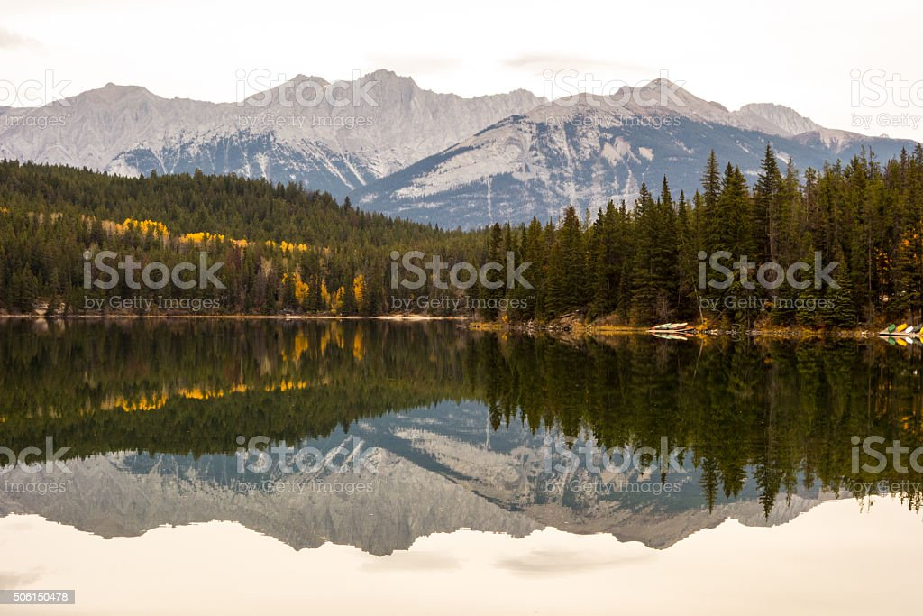 mountains and Trees Reflected in Pyramid Lake stock photo