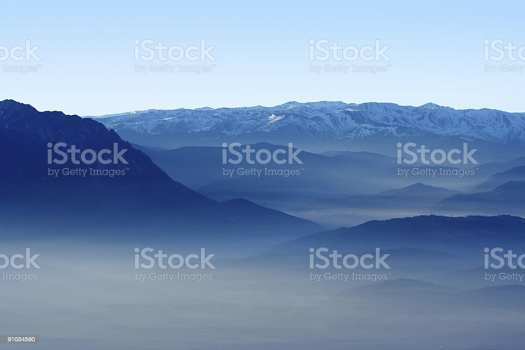 Mountains and valley in the fog royalty-free stock photo