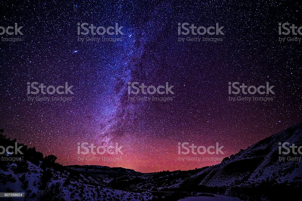 Mountains at Night with Milky Way Galaxy stock photo