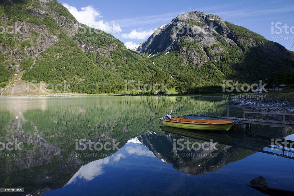 Mountains, Boat and Fjord stock photo