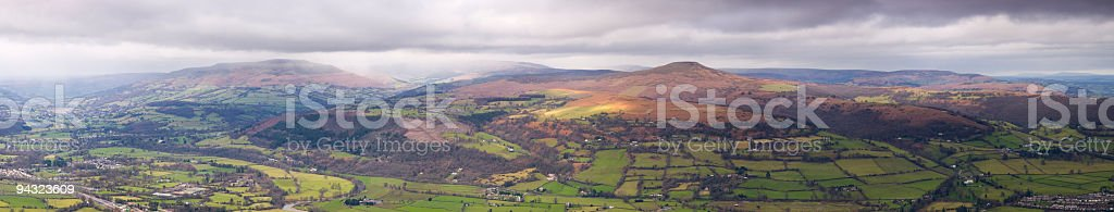 Mountains, farmland, dramatic sky stock photo