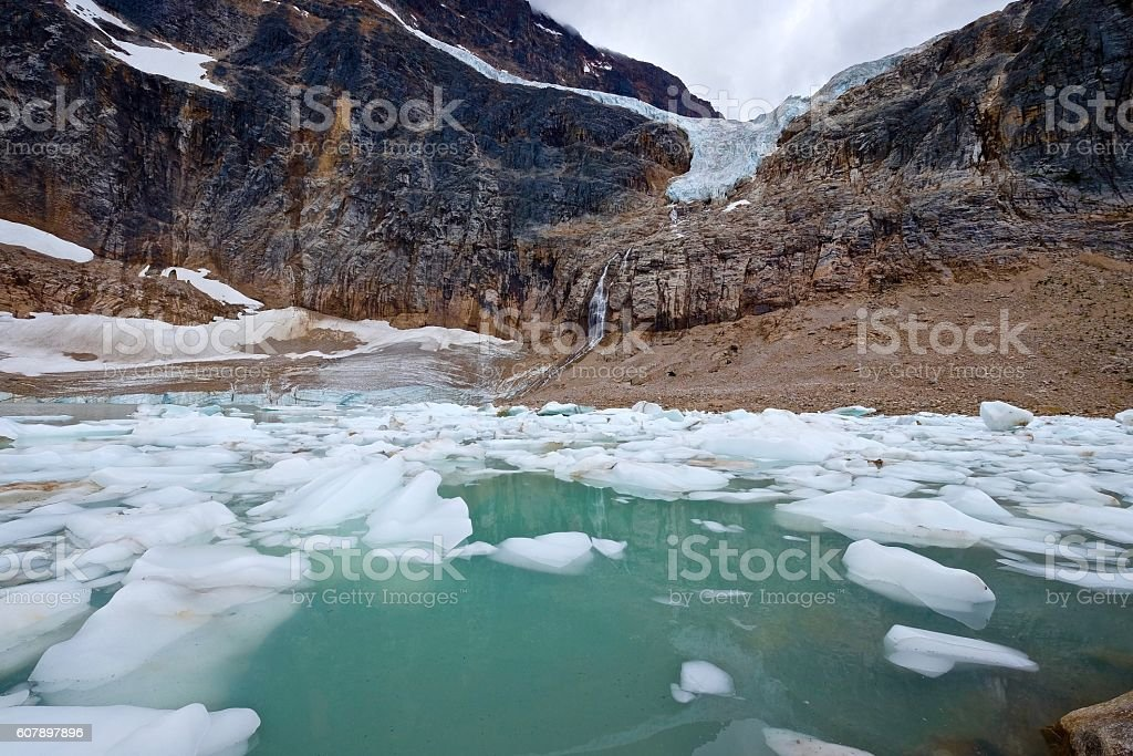 Mountains, glacier and alpine lake with icebergs. stock photo