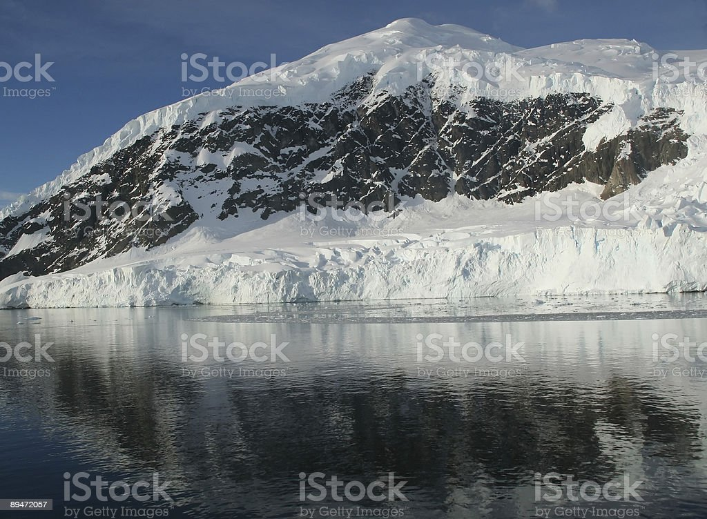 Mountains & glaciers reflected stock photo