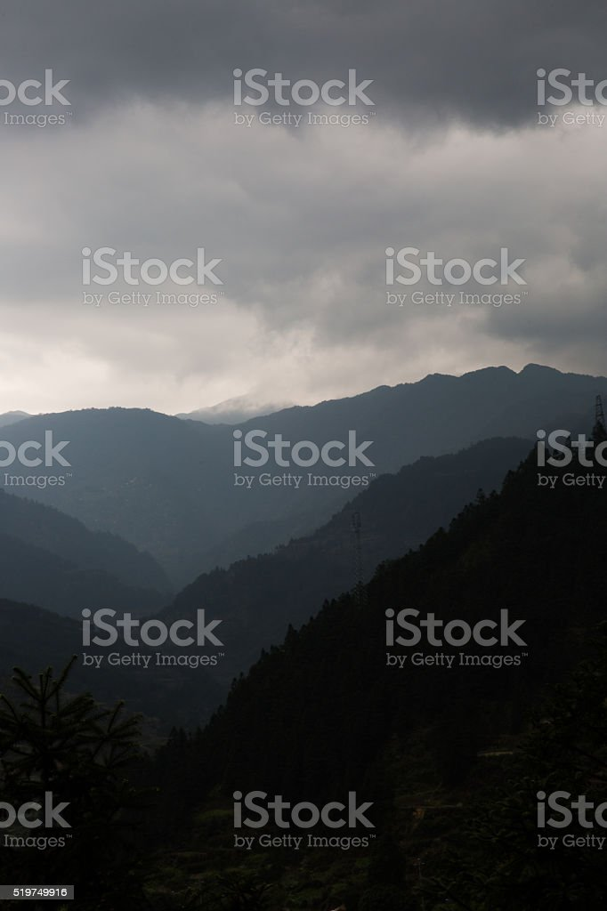 mountains in cloudy weather stock photo