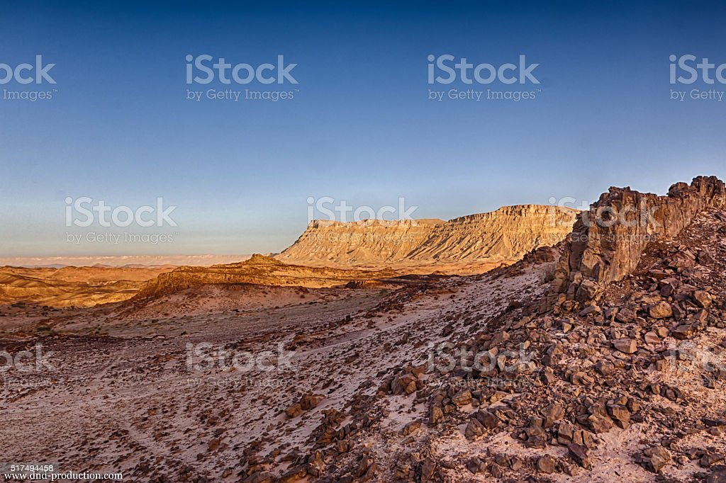 Mountains in the desert at sunrise sunset stock photo