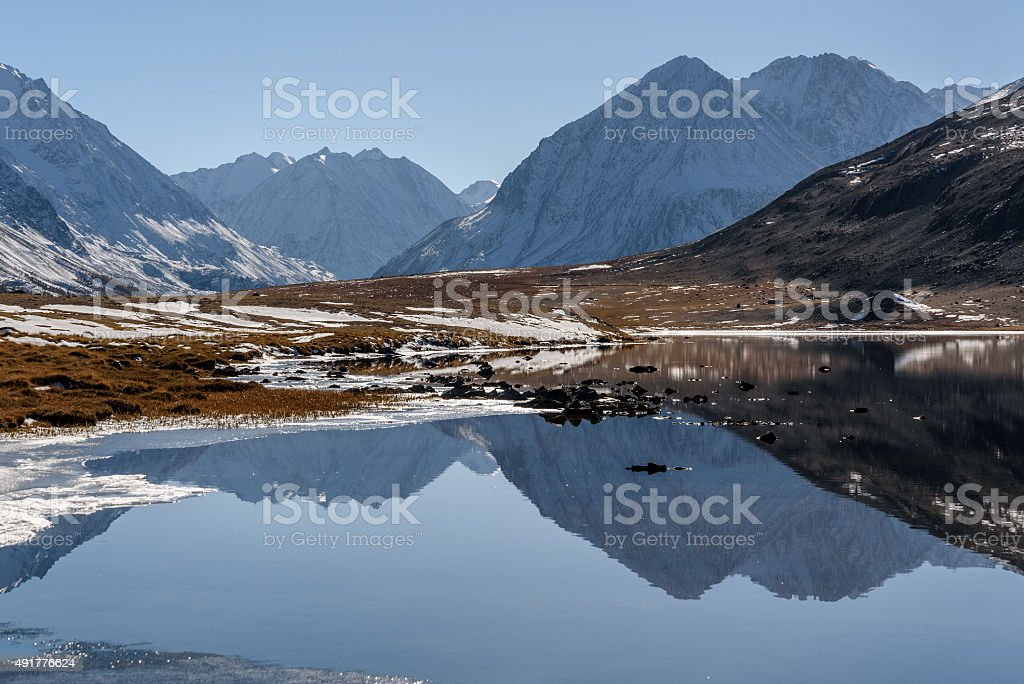 mountains lake reflection snow autumn stock photo