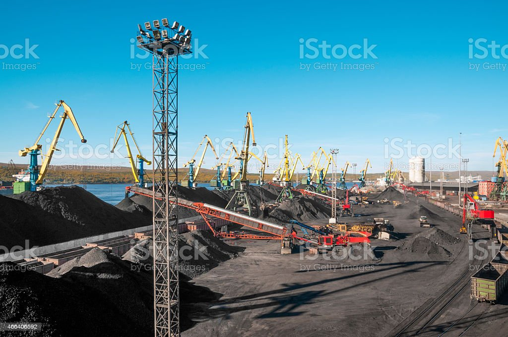 Mountains of coal in the port. stock photo