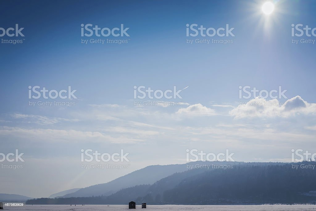 Mountains over Frozen Lake Champlain stock photo