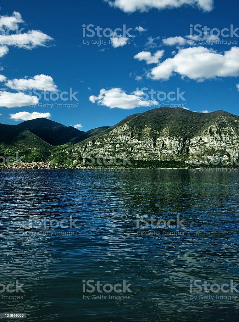Mountains over lake stock photo