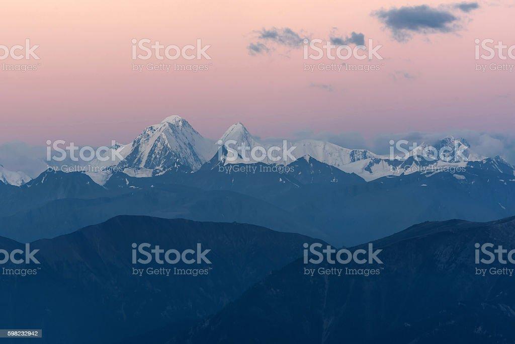 mountains peak snow sky sunrise stock photo