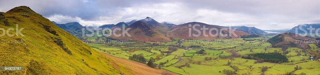 Mountains peaks, valley farms stock photo