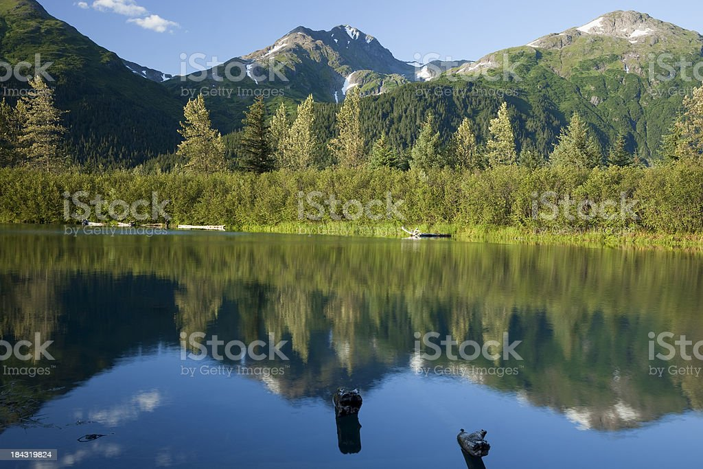 Mountains reflected in picturesque small lake, Portage Valley Alaska stock photo