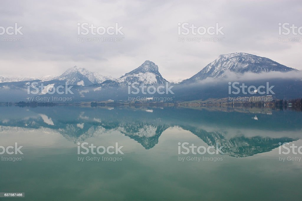 Mountains reflecting in a lake Wolfgangsee, Austria stock photo