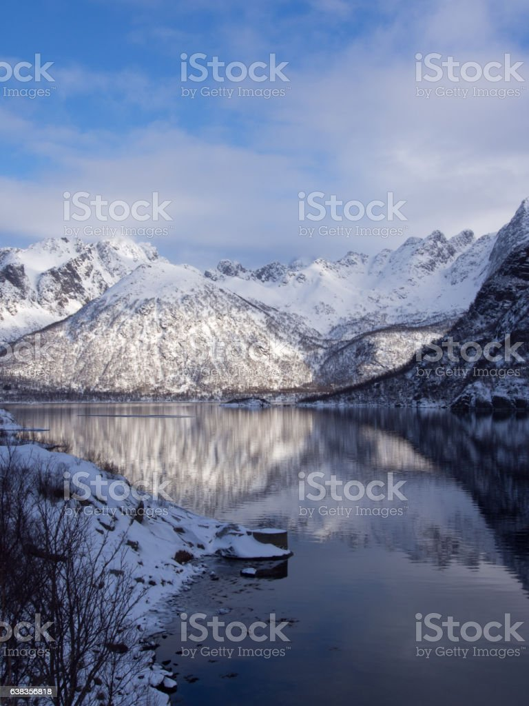 Mountains reflecting in the sea on Lofoten, Norway stock photo
