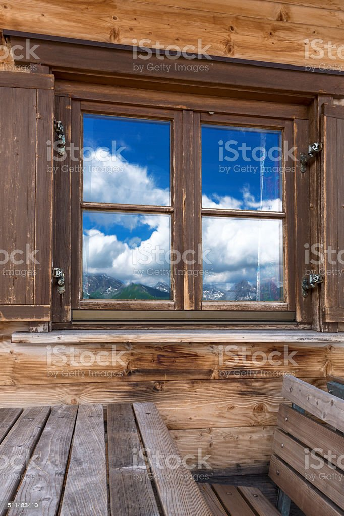 Mountains reflecting in the window stock photo