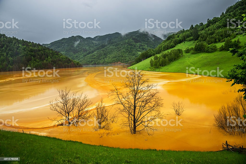 Mountains scenics with polluted water stock photo