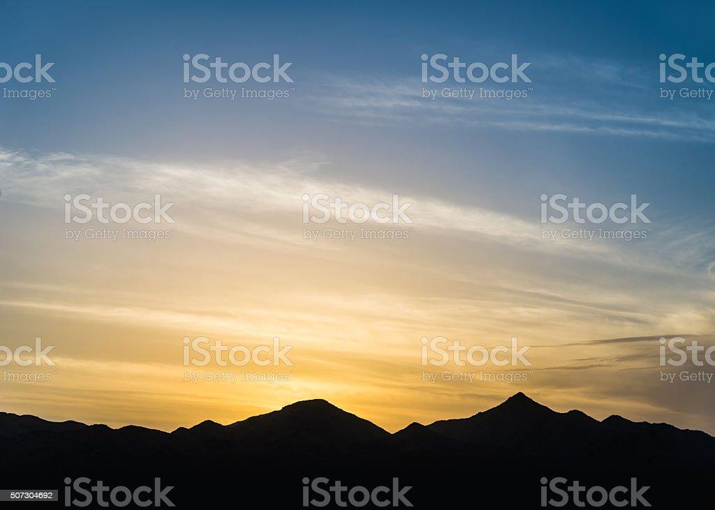 Mountains silhouette at sunset stock photo
