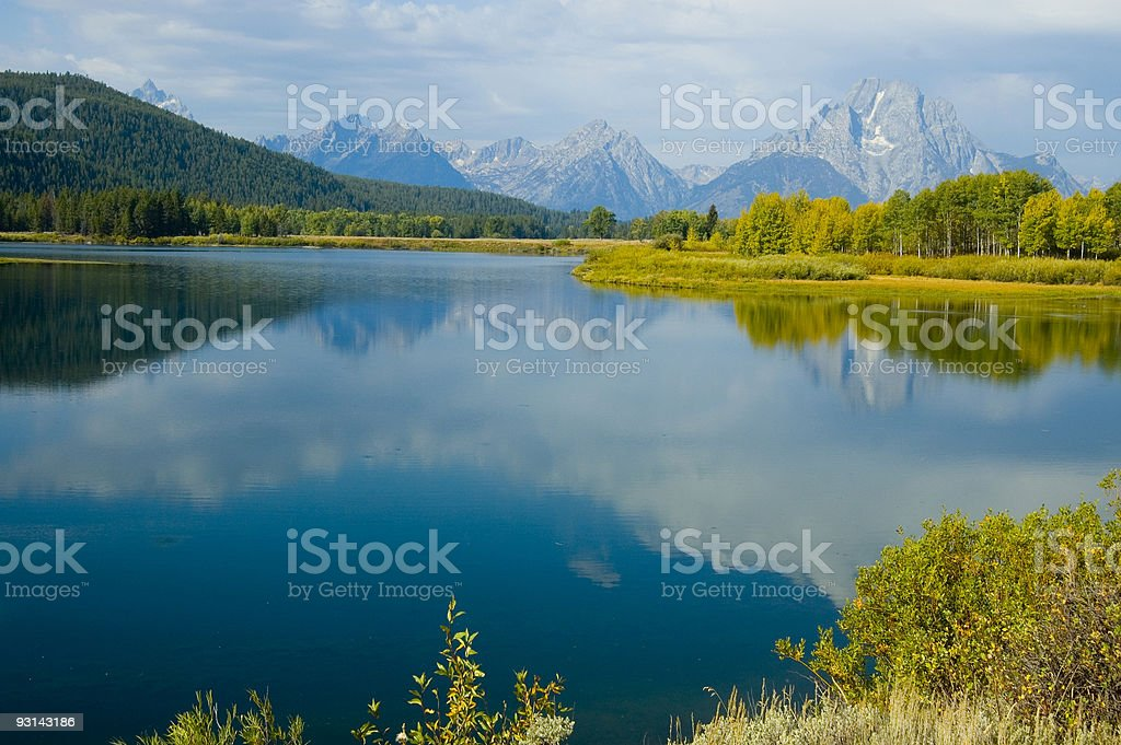 mountains, sky and fall colors reflected in lake royalty-free stock photo