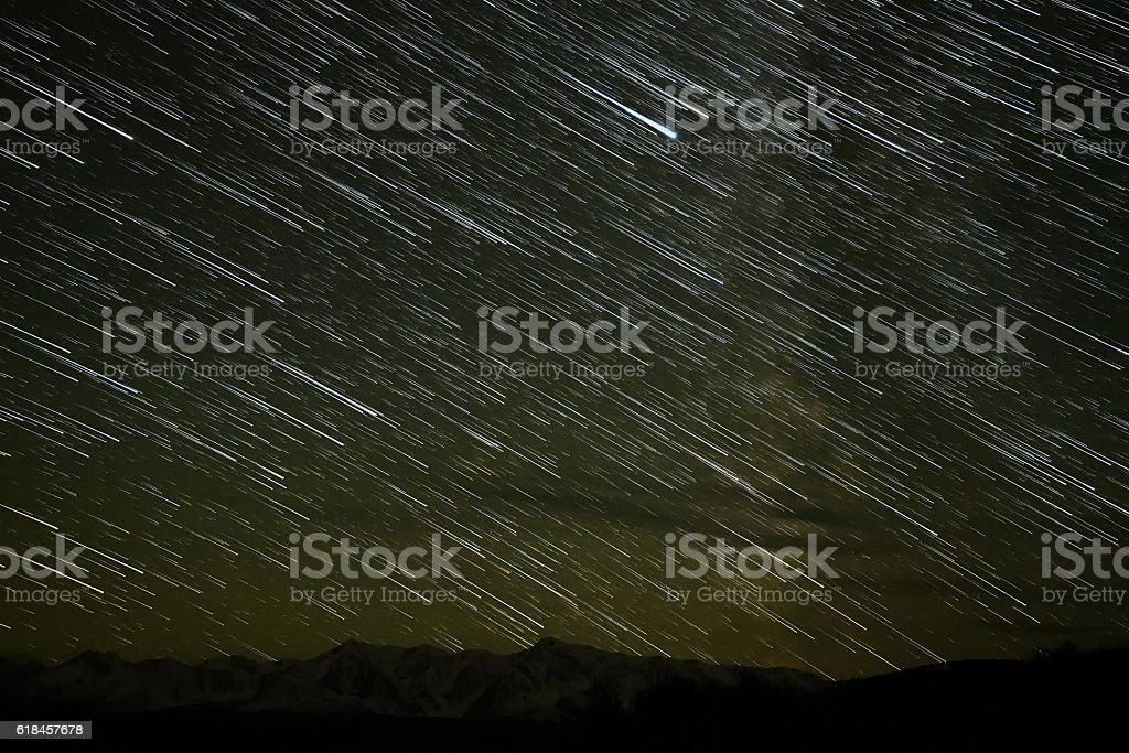 mountains star tracks sky stock photo