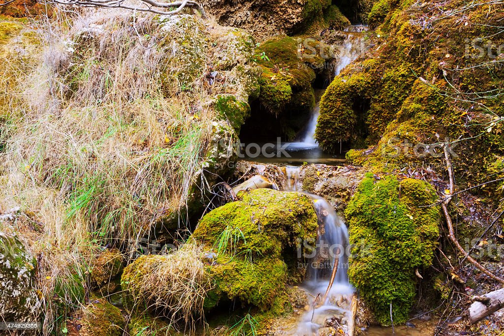 Mountains stream with moss stones stock photo