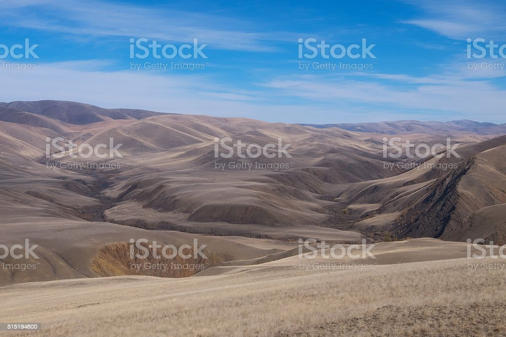 Mountains, the steppe and the sky stock photo