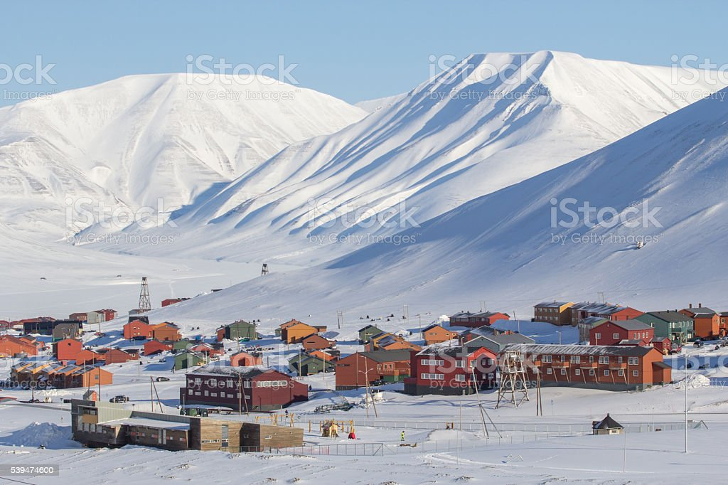 Mountains tower over Longyearbyen, Svalbard . Norway stock photo
