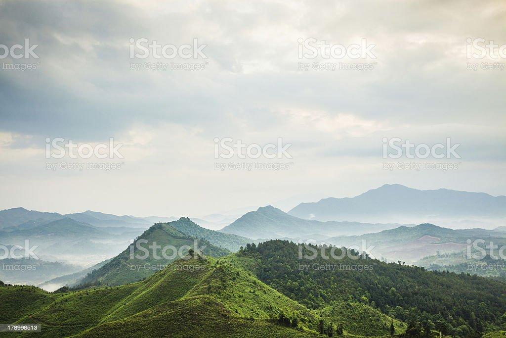 mountains under mist stock photo