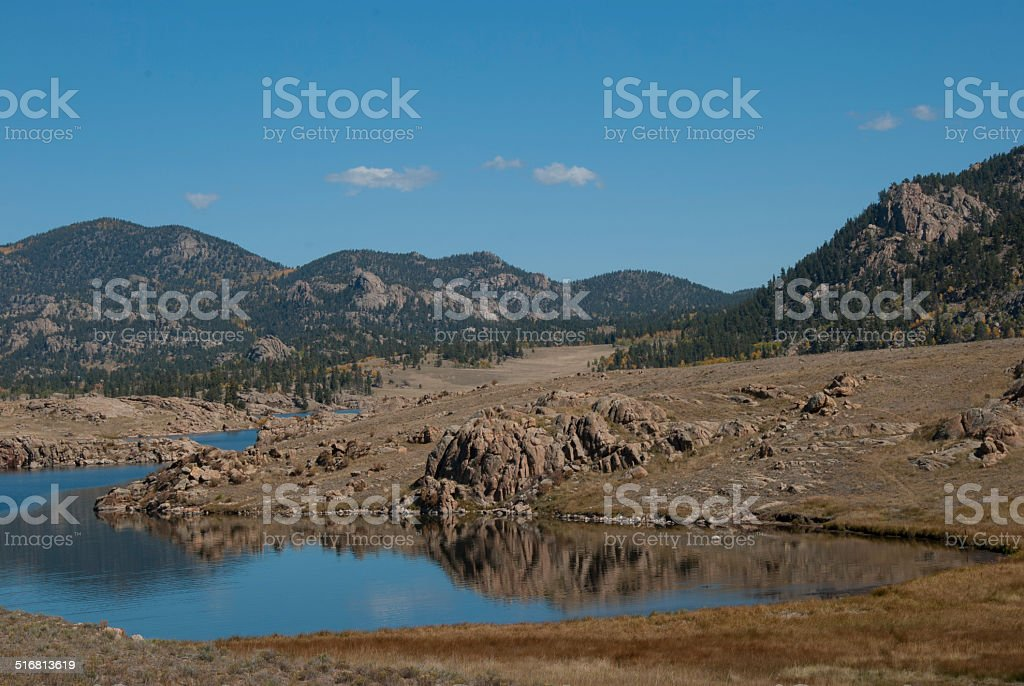 Mountains with reservoir in foreground stock photo