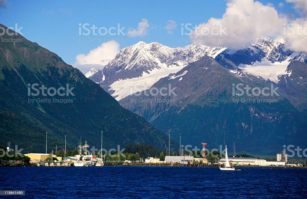 Mountains with snow and a view of harbor stock photo