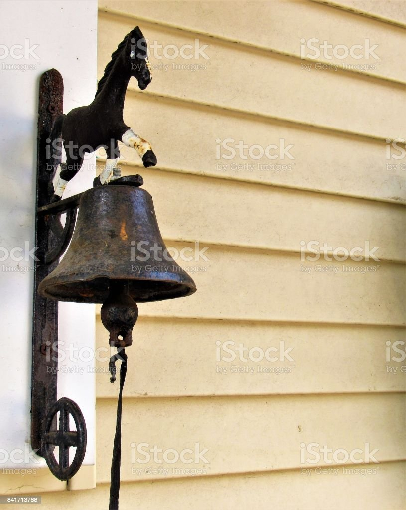 Mounted dinner bell with horse figure stock photo