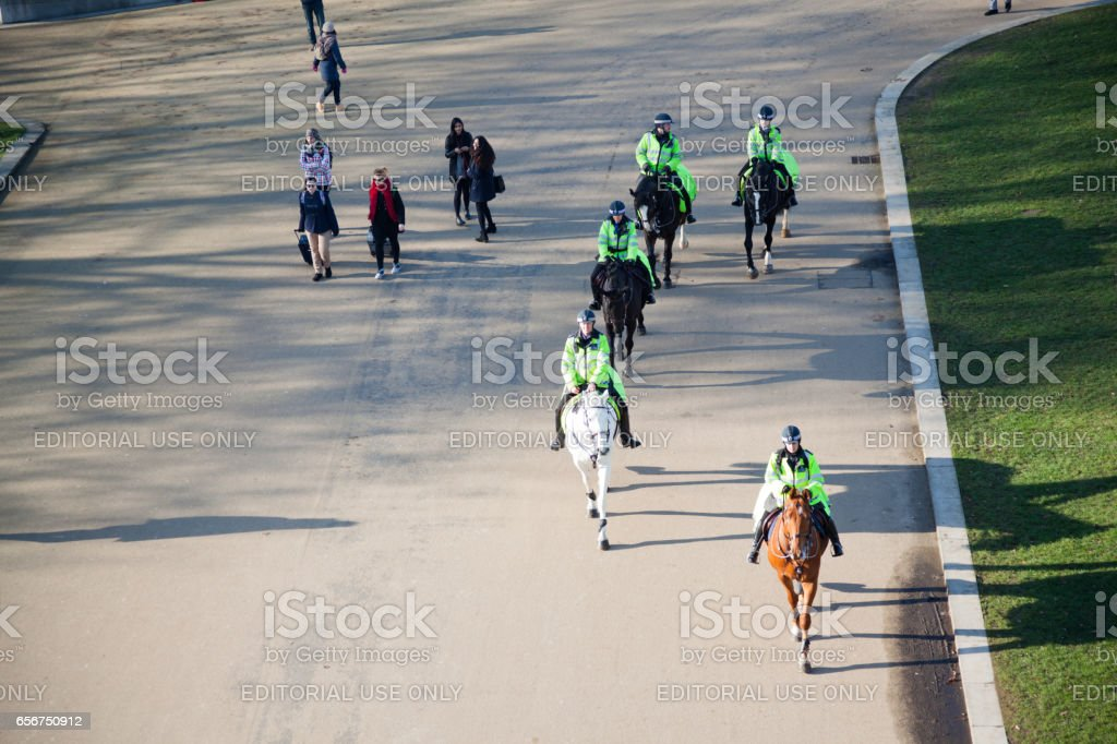 mounted police and passers-by near Hyde Park London stock photo