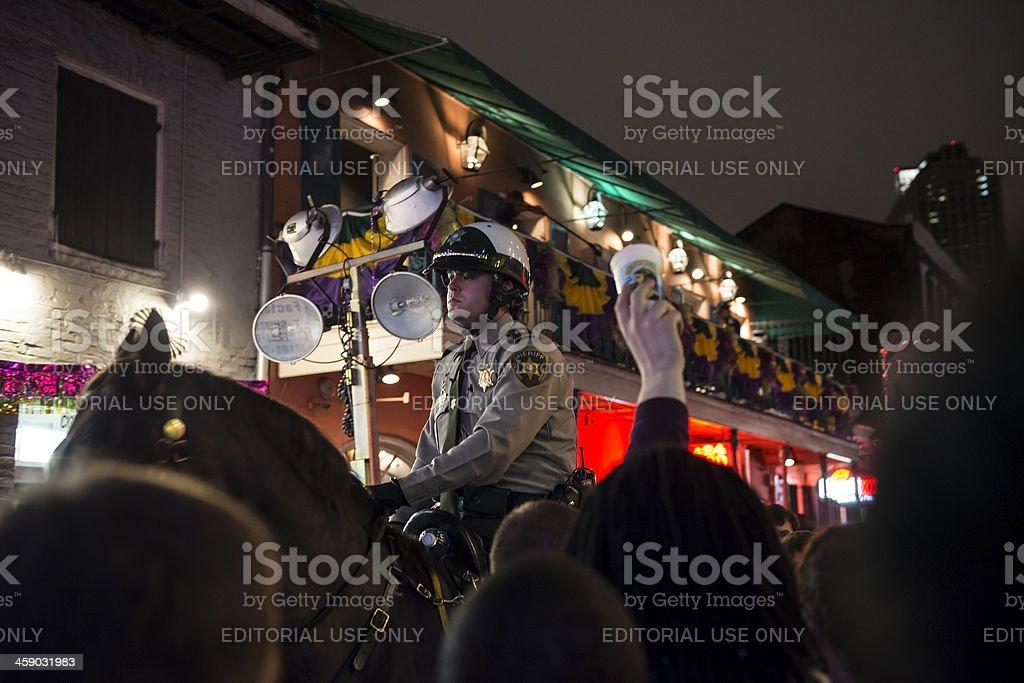 Mounted police on Bourbon Street at Mardi Gras stock photo