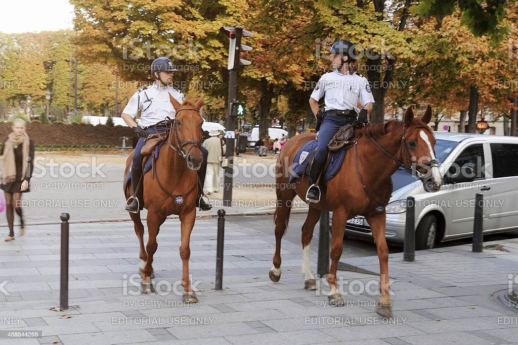 Mounted Police Ride Horse and Patrol in Paris - XLarge stock photo