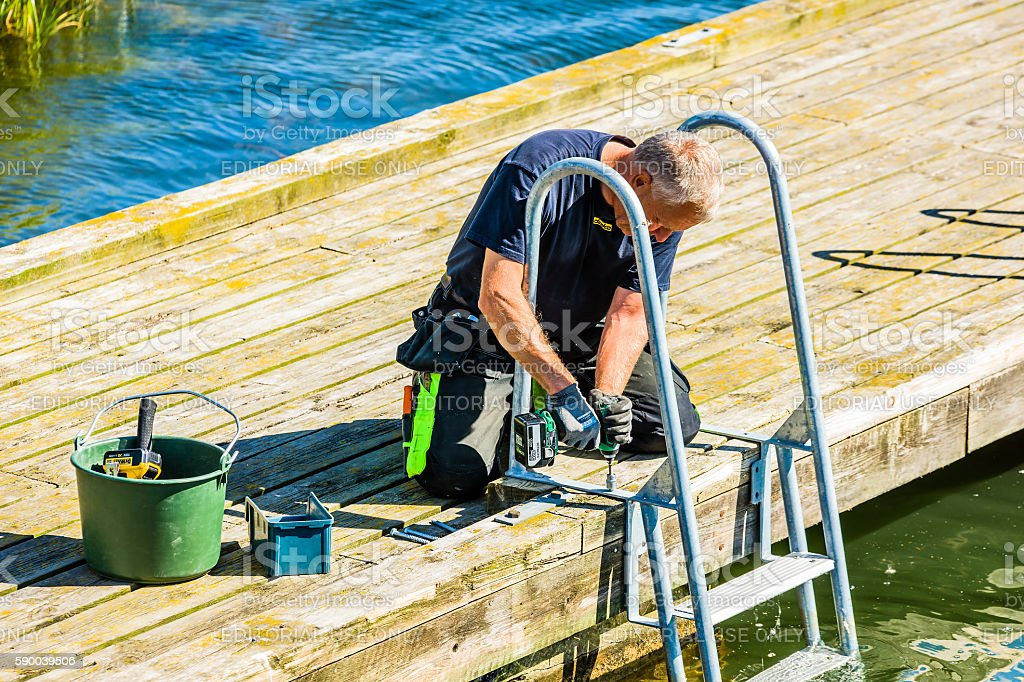 Mounting a ladder stock photo