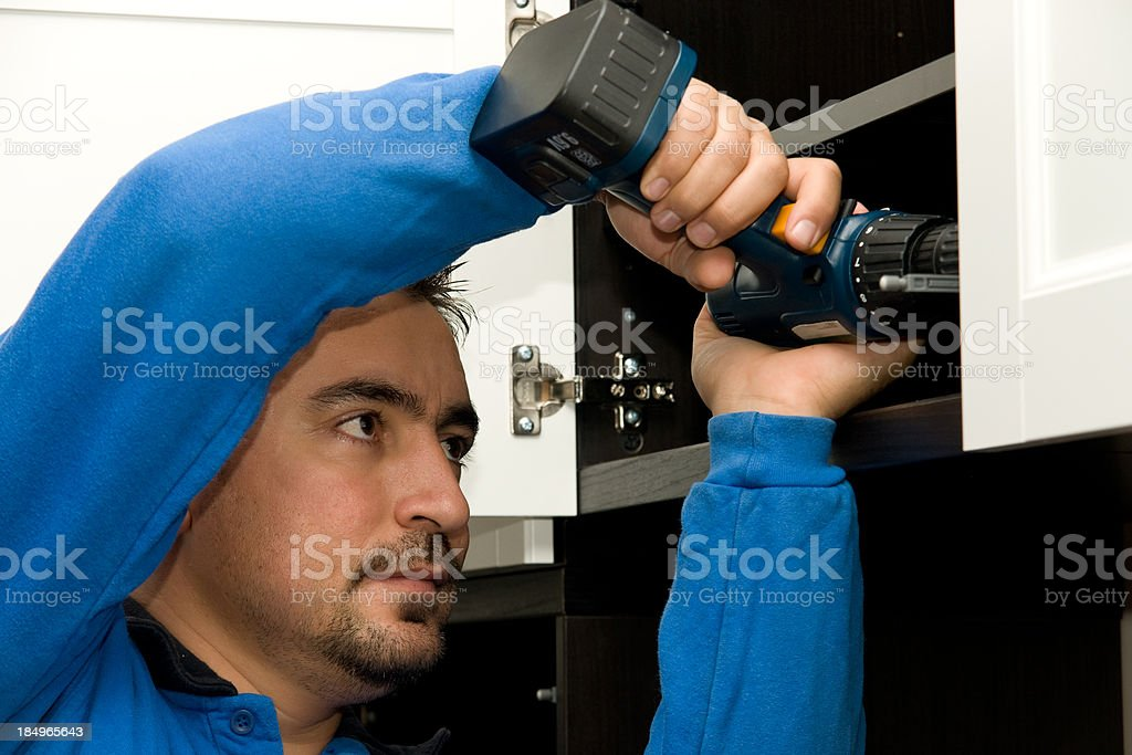 Mounting furniture with screwdriver royalty-free stock photo