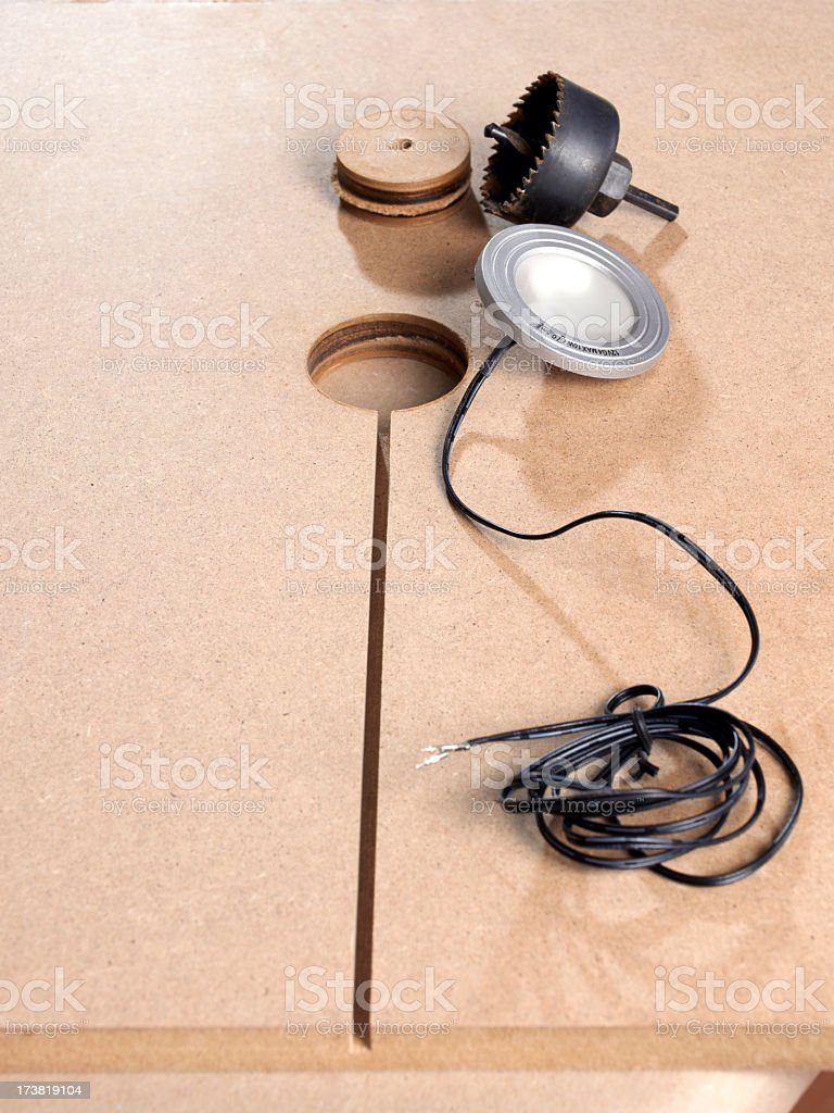 Mounting hologen lamp on a mdf fibreboard stock photo